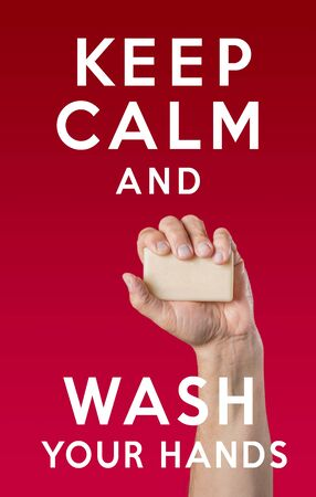 Caucasian male hand holding soap and the message: Keep Calm and Wash Your Hands