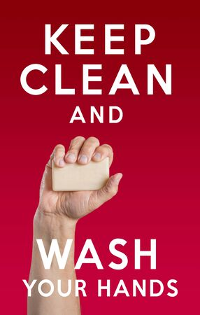 Caucasian male hand holding soap and the message: Keep Clean and Wash Your Hands Stok Fotoğraf