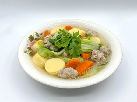 Clear Soup with Bean Curd and Minced Pork with white background.
