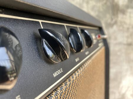 Close-up black knob,vintage combo amplifier.