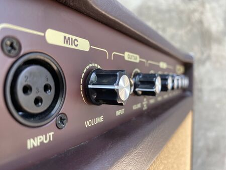 Close-up black knob, brown panel vintage acoustic combo amplifier. Stok Fotoğraf