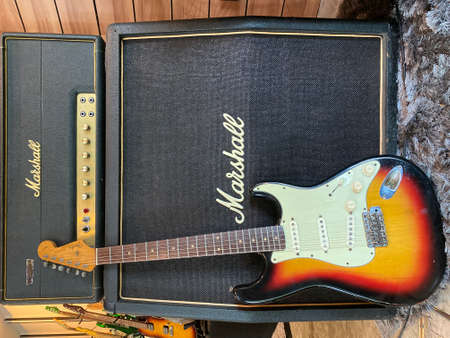 BKK, Thailand - May 7, 2020 : fender stratocaster sunburst original 1962 The legendary guitar that Many guitarists choose to use and Marshall JMP Super lead 1978 on a store.
