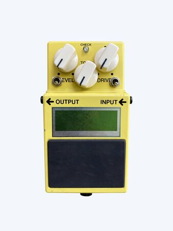Isolated yellow vintage Overdrive stomp box effect for electric guitar on white background with work path.