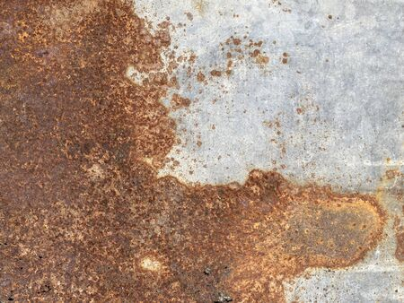 Yellow brown rust and dirt on Zinc Sheet. Rusted brown and satin silver abstract texture. metal surface rusted spots.metal rust background.