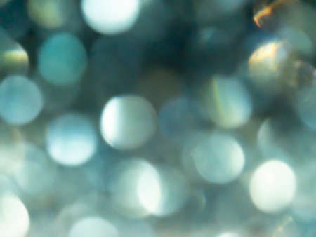 Abstract colorful Silver bokeh effect texture on black background. glitter vintage lights defocused elegant for Christmas or celebrate. Sparkling magical dust particles. Standard-Bild
