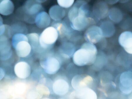 Abstract colorful blue bokeh effect texture on black background. glitter vintage lights defocused elegant for Christmas or celebrate. Sparkling magical dust particles. Standard-Bild