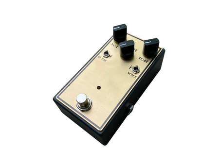 Isolated Gold boutique overdrive British style sound stompbox electric guitar effect for studio and stage performed on white background . side view photo. music concept.