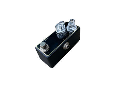Isolated black and gold striped overdrive stompbox electric guitar effect for studio and stage performed on white