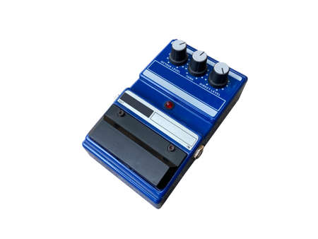Isolated octave stompbox electric guitar effect for studio and stage performed on white background side view photo. music concept. Stock Photo