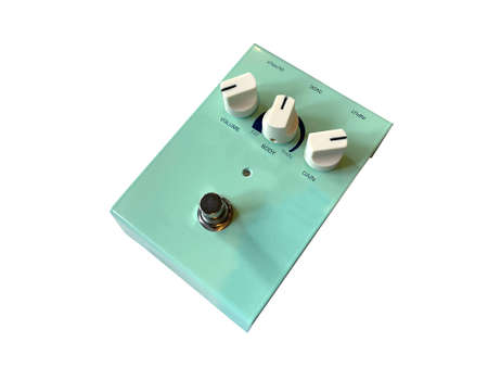 Isolated surf green stompbox electric guitar effect for studio and stage performed on white background. side view photo. music concept.