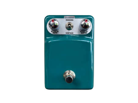Isolated dark green vintage and modern overdrive stompbox electric guitar effect for studio and stage performed on white background . music concept. Stock Photo