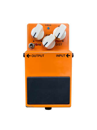 Isolated orange modifier classic overdrive stompbox electric guitar effect for studio and stage performed on white background . music concept.