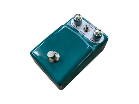 Isolated dark green vintage and modern overdrive stompbox electric guitar effect for studio and stage performed on white background . music concept. side view photo.