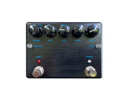 Isolated black wood texture distortion and cabinet simulator dual- channel stompbox electric guitar effect for studio and stage performed