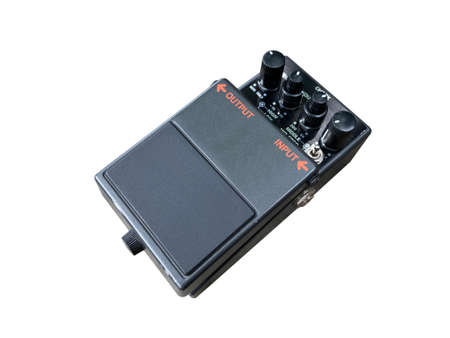 Isolated metallic black modifier distortion stompbox electric guitar effect for studio and stage performed on white background