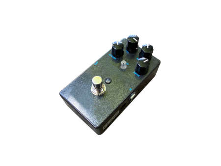 Isolated black metallic glitter distortion stompbox electric guitar effect for studio and stage performed on white background