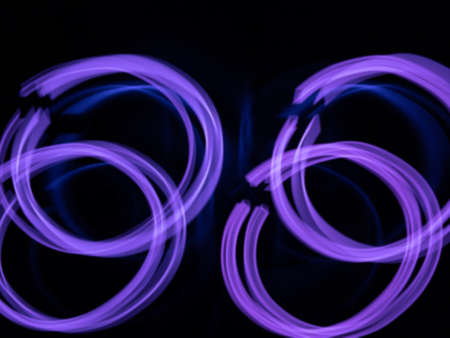 defocused purple neon lighting len flare wave pattern background in low shutter speed condition can use for overlay, texture and background in graphic design. technology concept.