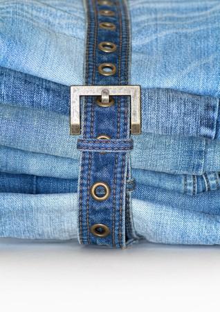 unworn: Stack Of Folded Blue Jeans With Jean Belt