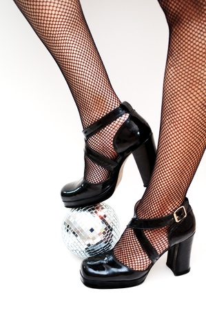 patent leather: dancers legs with disco ball