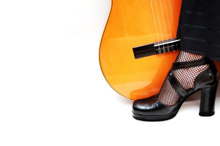 dancers foot with acoustic guitar photo
