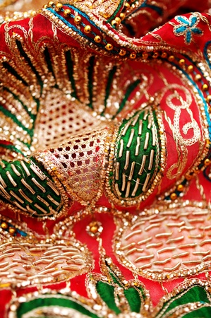 bead embroidery: golden red sequin embroidery with silky fabric
