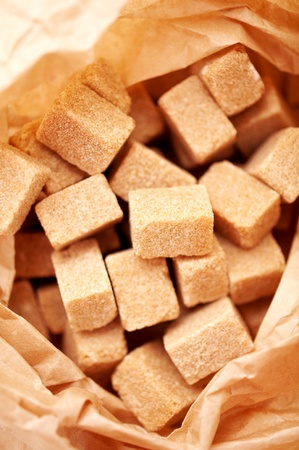 natural brown sugar cubes in sugar paper bag photo
