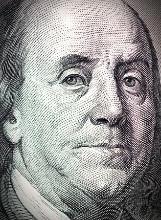 us currency: Benjamin Franklin face on one hundred dollar bill