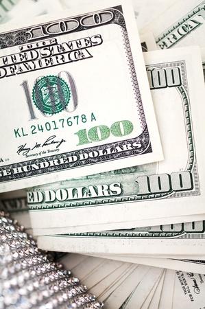 dollar bills with detail of luxury handbag photo