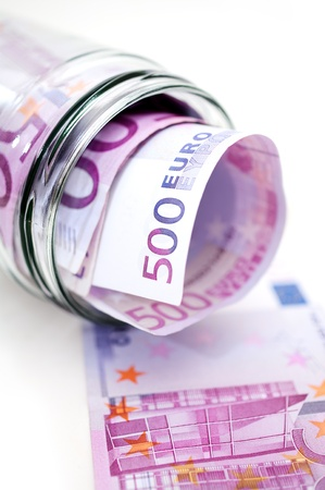 money jar: euro banknotes in money jar Stock Photo
