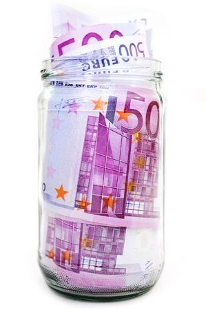 euro banknotes in money jar photo