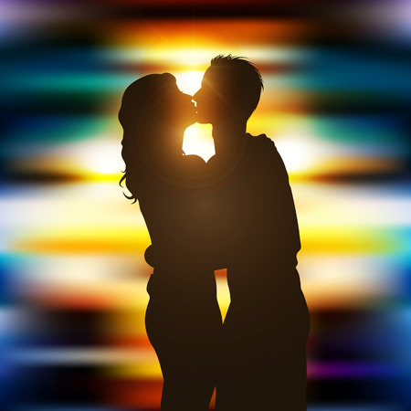 Silhouette of a kissing couple on beautiful city lights background