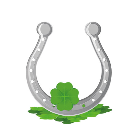 an isolated horseshoe and clovers for patricks day Vector