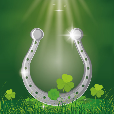 a green background with an isolated horseshoe for patricks day Vector