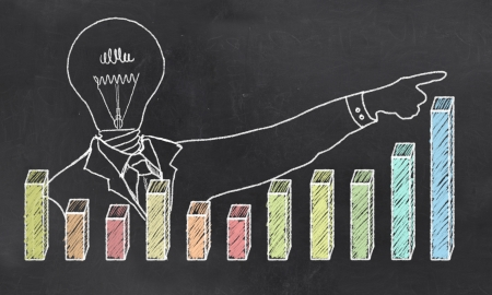 Growth with Creative Businessman showing Positive Graph photo