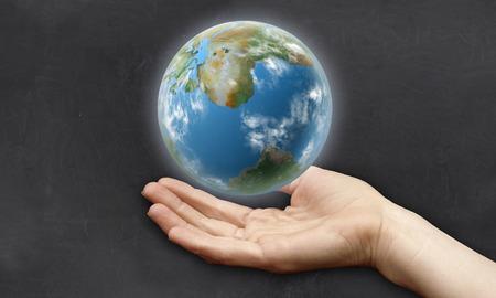 Hand unter der Erde mit Clean Tafel zum Schreiben Standard-Bild - 27705904