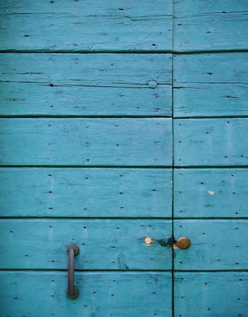 Photo of old blue vintage doors from wood in Venice.
