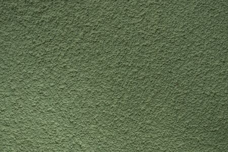 Green wall grain texture photo of background.