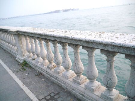 Old, vintage balusters near the Sea. Venice. Banque d'images