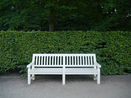 White bench in the park. Warsaw. Poland.