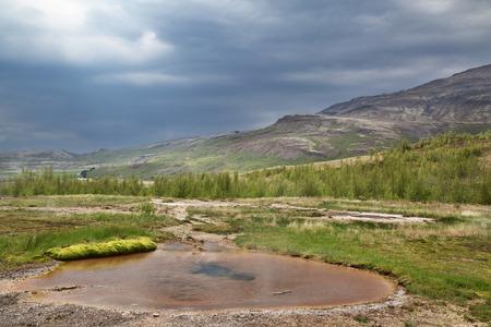 warm water: hot water spring Iceland beautiful green landscape Stockfoto