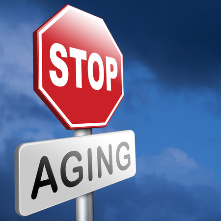 younger: stop aging stay young forever staying and looking younger than you are not growing old Stock Photo