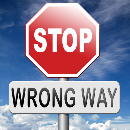 turn back: wrong way stop and turn back now bad direction making mistakes Stock Photo