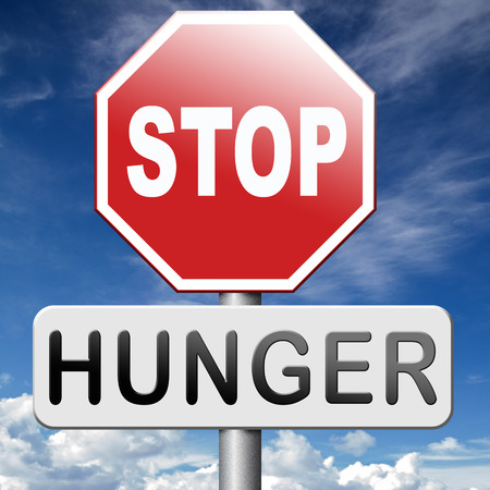 stop hunger feed the world no suffering malnutrition starvation and famine caused by food scarcity undernourished bad harvest aid Banque d'images
