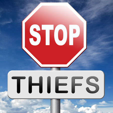 armed robbery: catch thiefs no theft arrest by police investigation or neighborhood watch online internet thief Stock Photo