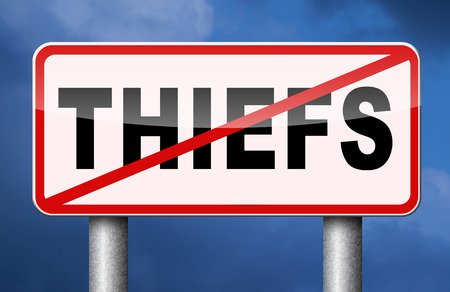 preventing: catch thiefs no theft arrest by police investigation or neighborhood watch online internet thief Stock Photo