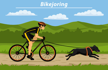 Man cycling bikejoring with his dog outside. outdoor workout.