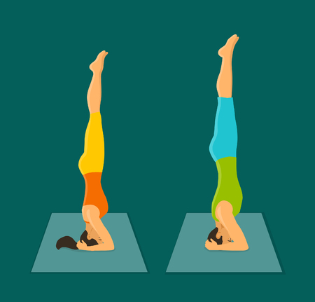 Man and Woman Headstand Pose. Couple practicing yoga sirsasana stand on head pose