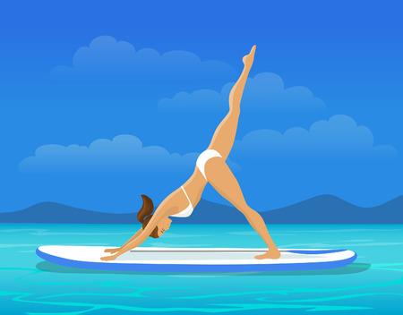 Woman doing Stand Up Paddling Yoga on Paddle Board on Water during Vacation at Seaside. Stand Up Paddle Yoga Workout