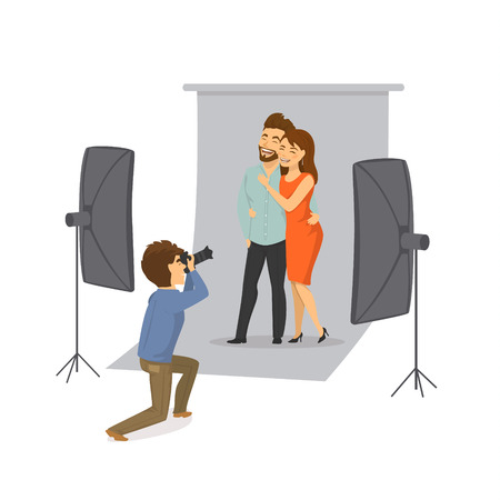 Couple making photo shooting with professional photographer in studio