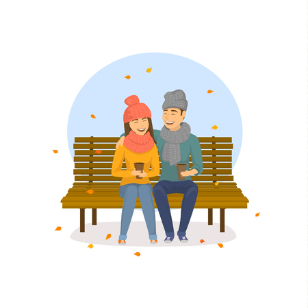 Cute romantic couple sitting on a bench in the park, autumn falling leaves scene